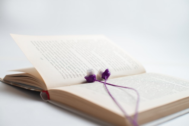 Headphones and book