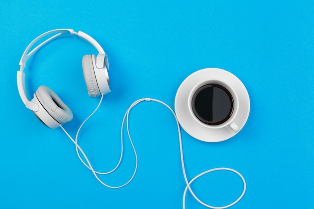 Headphones and coffee cup, top view