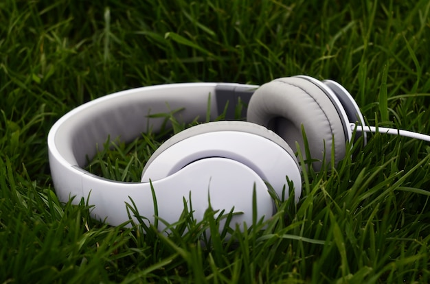 Headphones on green grass