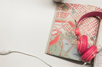 Headphones lying on map