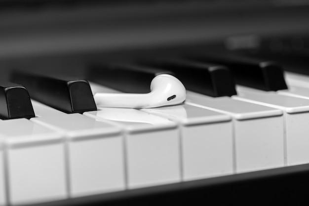 Headphones on musical synthesizer keyboard. earphones on electronic piano.