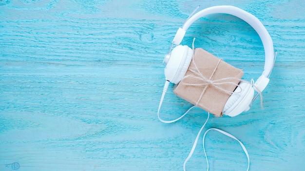 Headphones near gift box