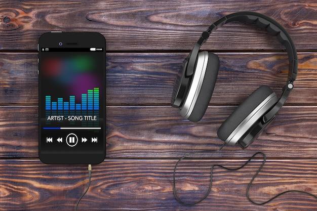 Наушники возле мобильного телефона с музыкальным плейлистом на деревянном столе. 3d-рендеринг.