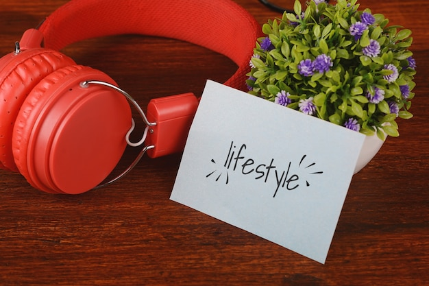Headphones and paper card with