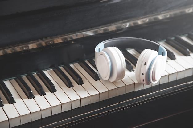 Headphones on the piano keyboard. music