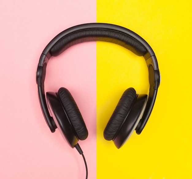 Headphones on pink and yellow background.