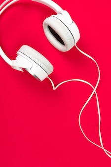 Headphones on red surface