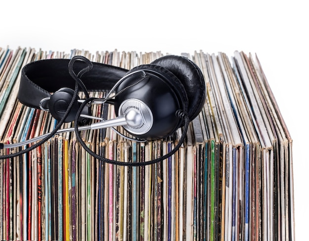 Headphones  and  stack of vinyle records.