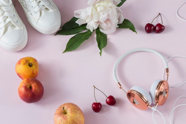 Headphones and trainers with fruit