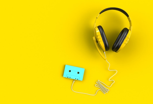 Headphones with blue cassette tape on yellow
