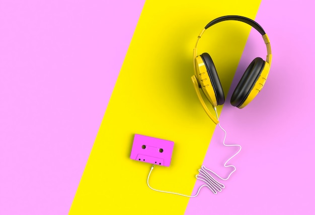 Headphones with pink cassette tape on pink and yellow background,