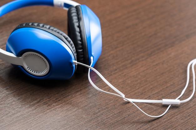 Headphones on wooden background