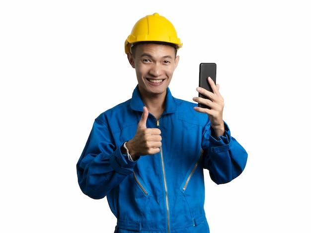 Headshot of engineer young man using mobile phone asian man.