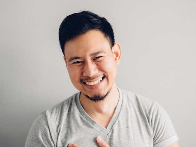 Headshot photo of asian man with laugh face.