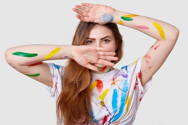 Headshot of serious female painter feels tired of having classes in art studio