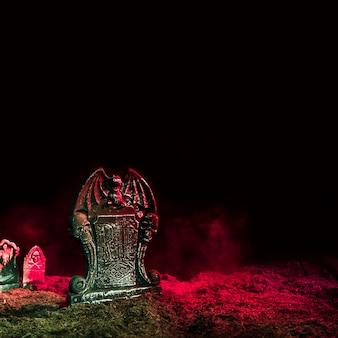 Headstones illuminated by pink light onground