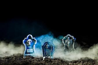 Headstones in heavy fog on soil