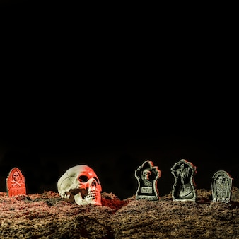 Headstones and skull on soil