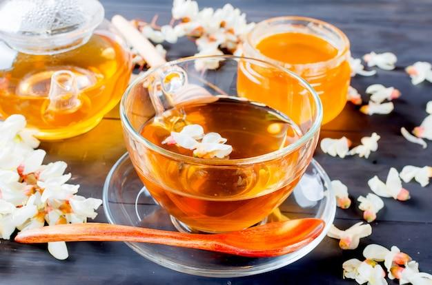 Healing acacia herbal tea and flowers