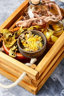Healing herbs in wooden box