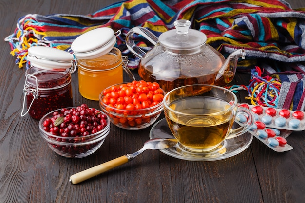 Healing tea from dried flowers of linden and dogrose  and fresh berries and honey is used in folk medicine