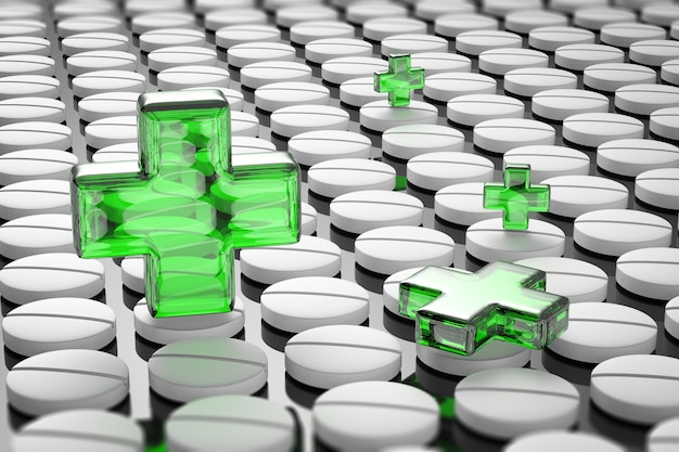 Концепция здоровья и безопасности с зеленым крестом на фоне таблеток