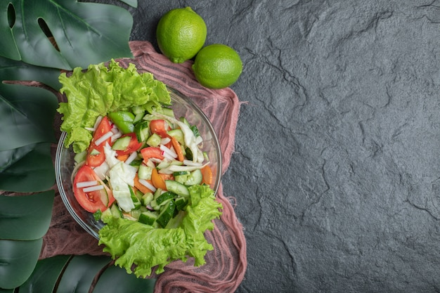 Health beauty. vegetable salad and lime on black background . high quality photo