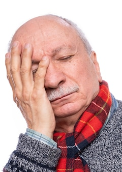 Health care concept. senior man suffering from headache over white background