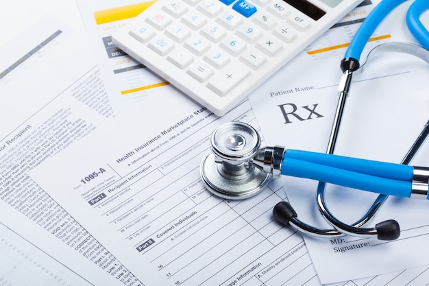 Health care costs, stethoscope and calculator
