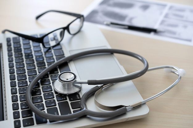Health care writing prescription doctor working with laptop computer