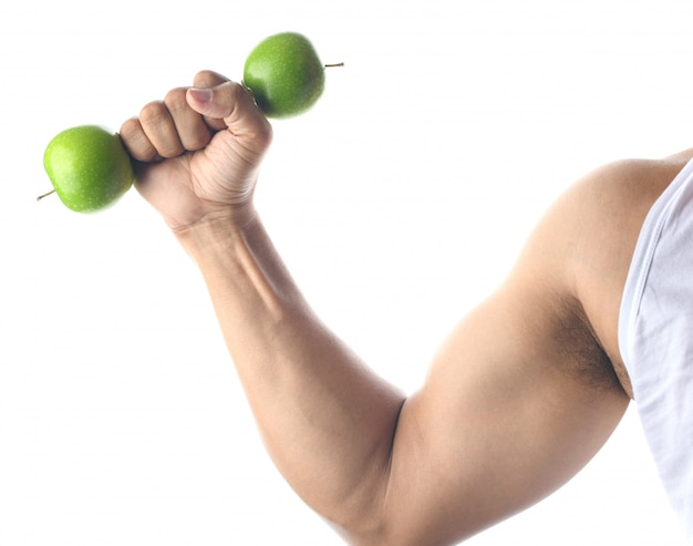 Health concept, green apple and arm muscle on white background.