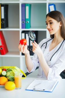 Health. diet and healthy. doctor dietitian holding in hands fres