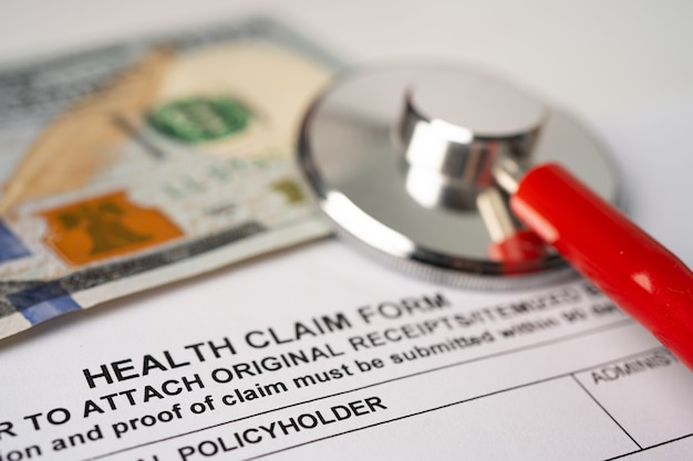 Health insurance accident claim form with stethoscope.