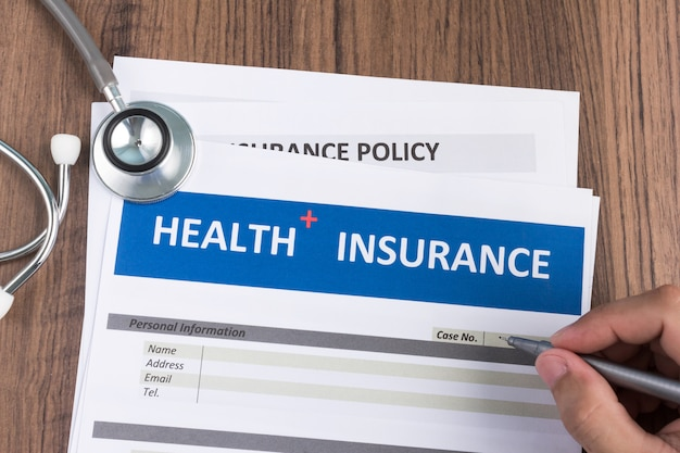 Health insurance form in man hand