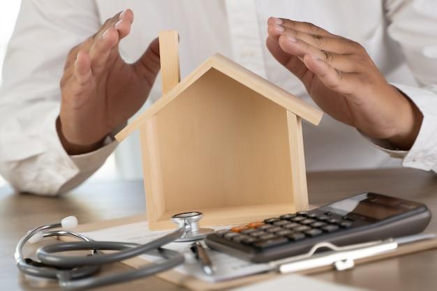健康保険住宅保険またはローン不動産不動産業者医療医療の概念図