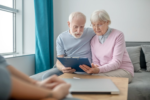 Health insurance. senior couple talking to insurance company agent and looking involved
