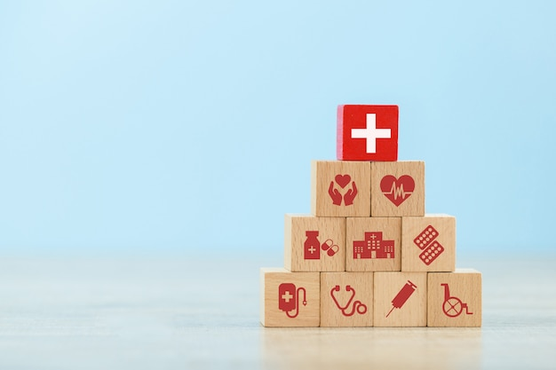 Health insurance wood block stacking with icon healthcare medical.