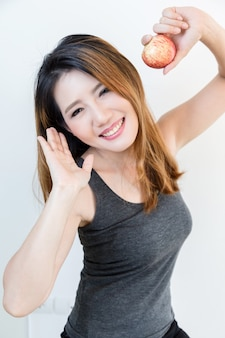 Health lifestyle concept, beautiful young woman hold red apple with smile.