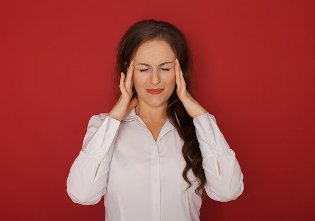 Health and pain. stressed exhausted young woman having strong tension headache.