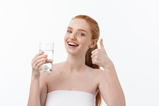 Health, people, food, sports, lifestyle and beauty content - smiling young woman with glass of water.