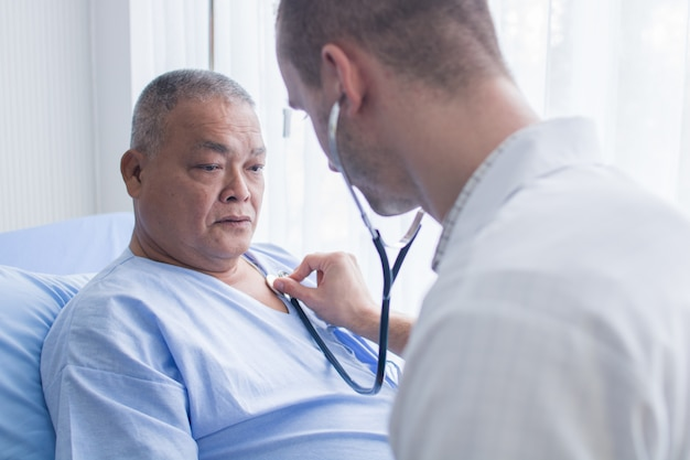 Healthcare and checking pressure, doctor use stethoscope for measurement of old patient