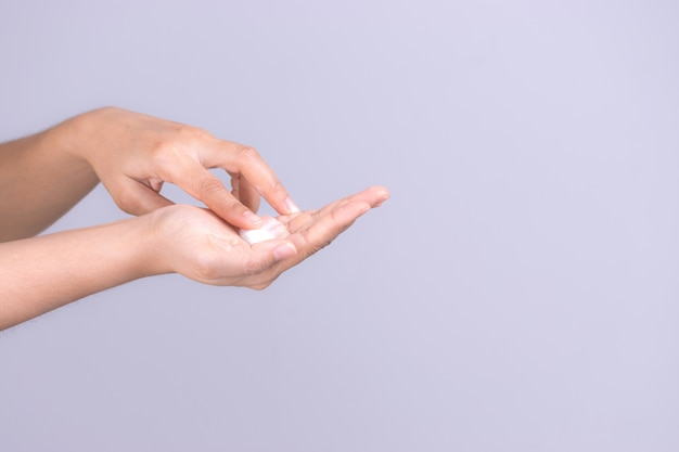 Healthcare concept. closeup shot of young woman hands applying moisturizing hand cream.
