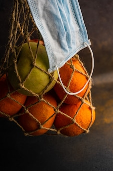 Healthcare concept with organic oranges in recyclable string bag