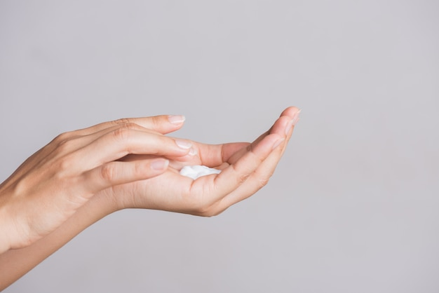 Healthcare concept. woman hands applying moisturizing hand cream.