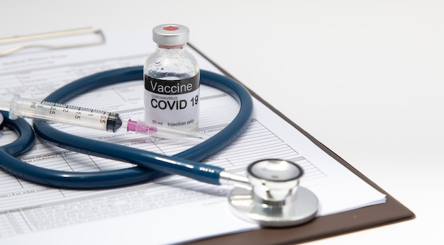 Healthcare and medical background concept. covid 19 vaccine or coronavirus vaccine with needle, prepare for injection
