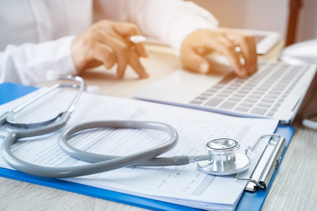 Healthcare medical concept, doctor working searching information about patient database