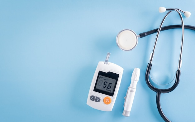 Healthcare and medical concept stethoscope and blood glucose meter sets