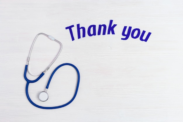 Healthcare and medical concept, stethoscope blue colored and text thank you