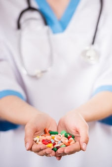 Healthcare and medicine. close-up of doctor holding pills.