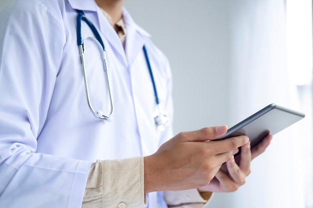 Healthcare and medicine. doctor using a digital tablet computer at work.